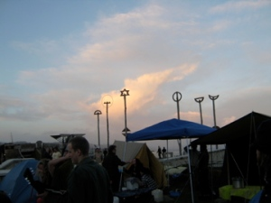 golden clouds as dusk falls over the encampment, day three