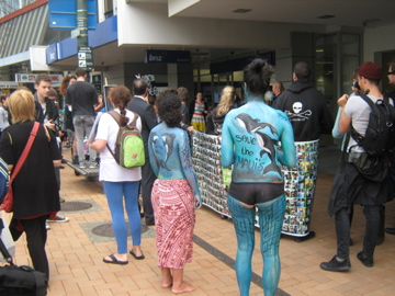 Some staunch painted laydees marching for Maui's Dolphins